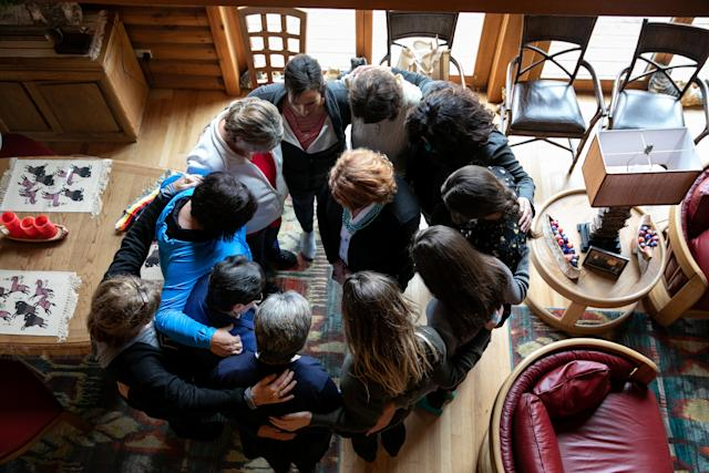 Women who met with Heitkamp at a home on the reservation of the Turtle Mountain Band of Chippewa Indians surrounded her to offer a blessing. (Ilana Panich-Linsman for HuffPost)