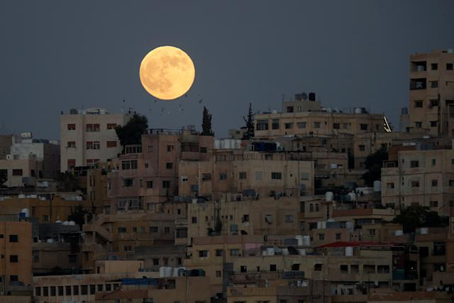 The moon is seen before a lunar eclipse over Amman