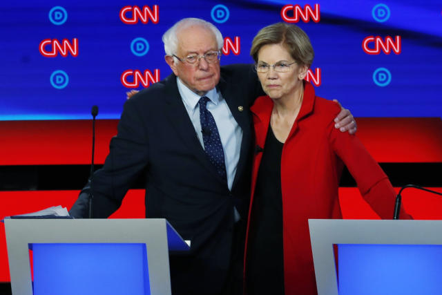 FILE - In this July 30, 2019 file photo, Sen. Bernie Sanders, I-Vt., and Sen. Elizabeth Warren, D-Mass., embrace after the first of two Democratic presidential primary debates hosted by CNN in the Fox Theatre in Detroit. (AP Photo/Paul Sancya)