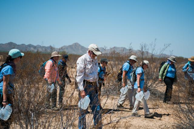 Clergy members and activists with the migrant aid group No More Deaths hike into the Cabeza Prieta National Wildlife Refuge on August 5, 2018. (Ash Ponders)