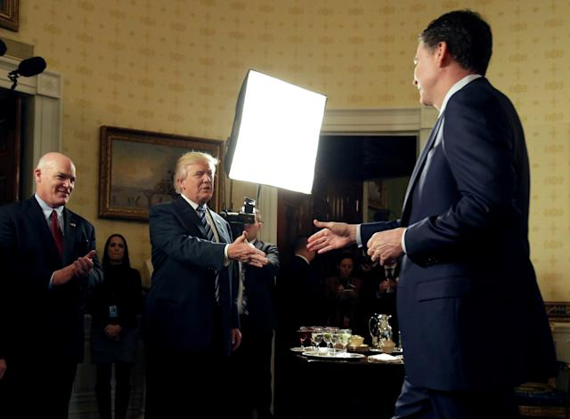 President Donald Trump greets then-FBI Director James Comey in the Blue Room of the White House on Jan. 22, 2017. (Joshua Roberts / Reuters)