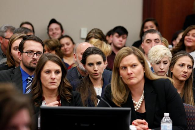 Rachael Denhollander (center) listens as Larry Nassar is sentenced. (Brendan McDermid / Reuters)