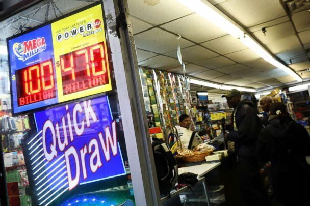 PHOTO: Signs display the jackpots for Mega Millions and Powerball lottery drawings as customers line up at a store in midtown Manhattan in New York, Oct. 19, 2018. (Mike Segar/Reuters)