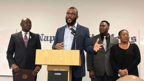 PHOTO: Filmmaker Tyler Perry, center, speaks to a a press conference announcing a lawsuit against former Collier County Sheriff's Deputy Steven Calkins, Sept. 4, 2018 in Naples, Fla. (AP)