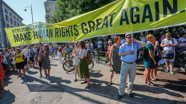 PHOTO: People take part in a demonstration calling for human rights and democracy in Helsinki, Finland, July 16, 2018, on the day of the summit between President Donald Trump and Russian President Vladimir Putin. (Pekka Sipola/EPA via Shutterstock)