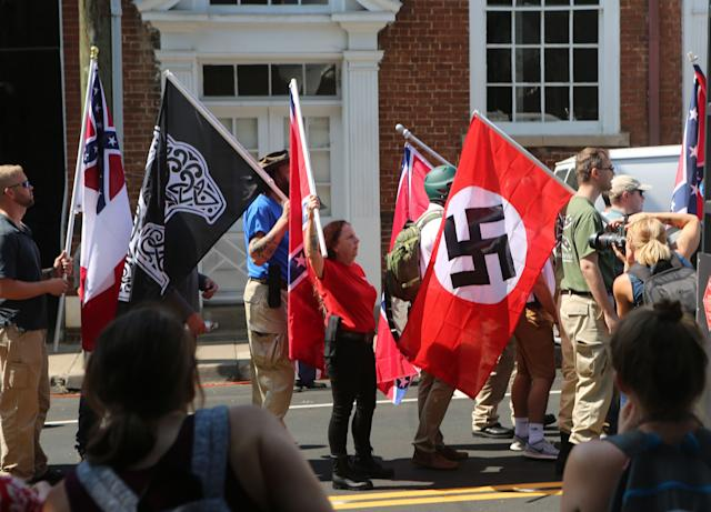 """A Nazi flag flies during the """"Unite the Right"""" white supremacist rally in Charlottesville, Virginia, on Aug. 12, 2017. (Photo: Andy Campbell / HuffPost)"""