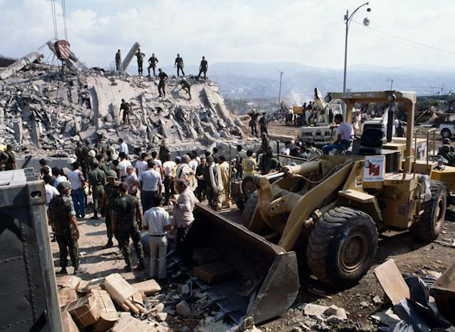 This is the scene around the U.S. Marine base near Beirut airport on Oct. 23, 1983 following a massive bomb blast that destroyed the base and caused a huge death toll rising to 239. (Photo: Mark Foley/AP)