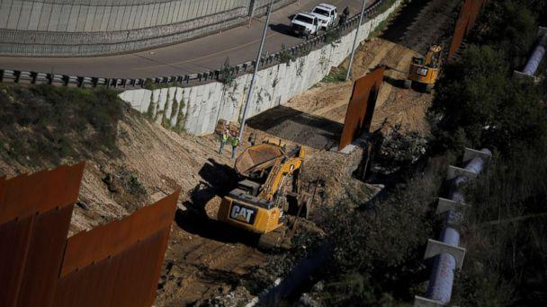 PHOTO: Workers are seen next a construction site of the border fence between United States and Mexico, seen from Tijuana, Mexico, Dec. 19, 2018. (Carlos Barria/Reuters, FILE)