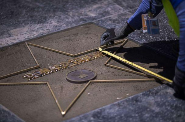 PHOTO: Workers replace the Star of President Donald Trump on the Hollywood Walk of Fame after it was destroyed by a vandal in the early morning hours on July 25, 2018 in Los Angeles, California. (David McNew/AFP/Getty Images)