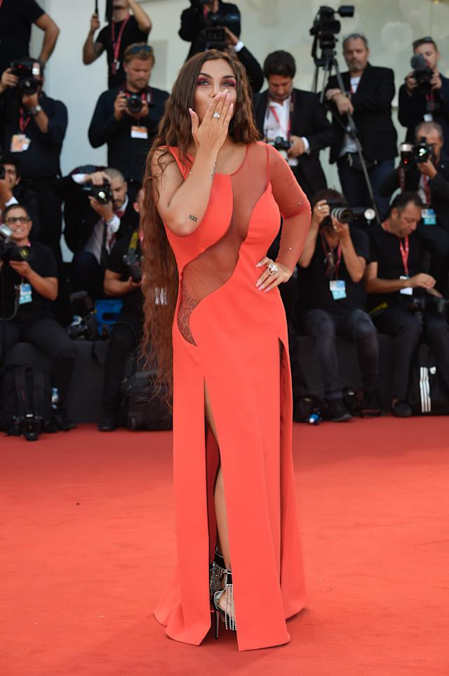 Elettra Lamborghini's sheer panel across her scarlet gown stole the show. Photo: Getty