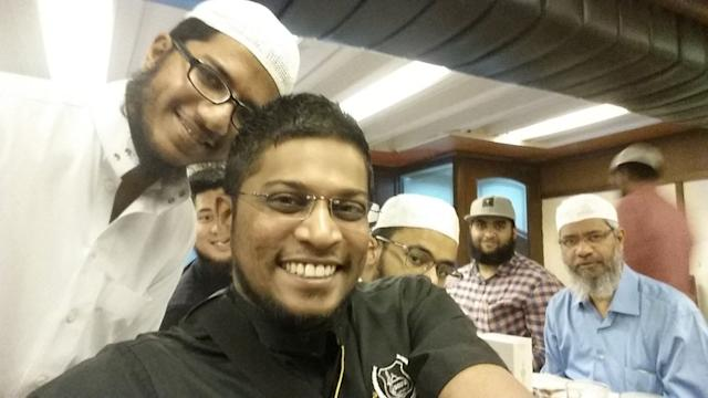 Zamri Vinoth (in black) is pictured during a meeting with controversial preacher Dr Zakir Naik (far right). — Picture via Twitter
