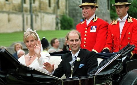 Prince Edward and Sophie Rhys-Jones pictured in their carriage after their wedding in 1999 - Credit: SINEAD LYNCH/EPA
