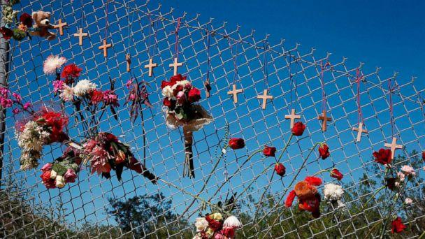 PHOTO: Flowers and crosses line a fence near the school on a makeshift memorial for the victims of the Marjory Stoneman Douglas High School shooting in Parkland, Fla., Feb. 16, 2018. (Rhona Wise/AFP/Getty Images)