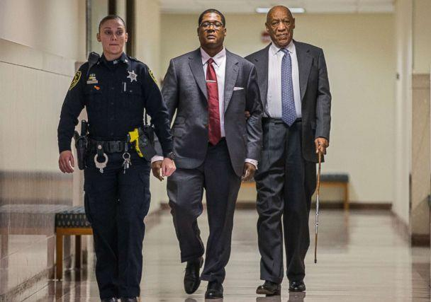 PHOTO: Bill Cosby, right, holds onto Andrew Wyatt as they are escorted by an officer for a short break during the second day of jury selection in his sexual assault retrial, at the Montgomery County Courthouse in Norristown, Pa., April 3, 2018. (Michael Bryant/Pool photo via AP)
