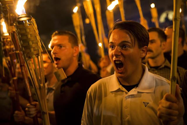 White supremacists march through the University of Virginia campus with torches in Charlottesville, Va., Aug. 11, 2017. (Photo: Samuel Corum/Anadolu Agency/Getty Images)