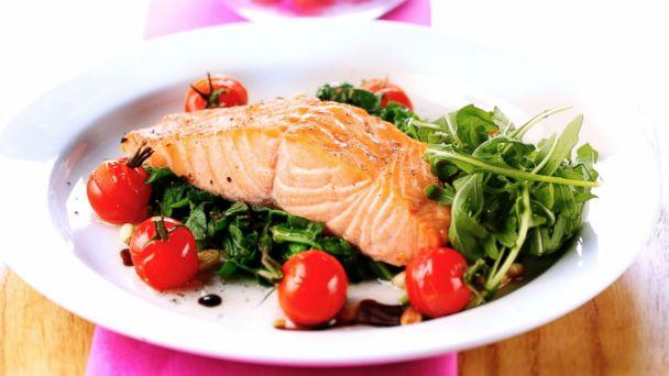 PHOTO: Salmon is served on a bed of spinach in this undated stock photo. (STOCK PHOTO/Getty Images)