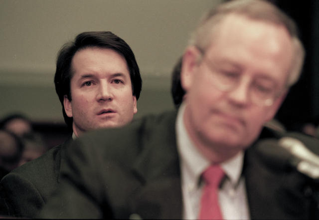 Brett Kavanaugh, associate counsel in the Office of Independent Counsel Kenneth Starr, sits behind Starr during his testimony before the House Judiciary Committee regarding the possible impeachment of President Bill Clinton on Nov. 19, 1998, in Washington, D.C. (Photo: David Hume Kennerly/Getty Images)