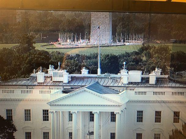 PHOTO: Camera shot facing south over the White House - you can see the flag at the WH at full staff while the flags surrounding the Washington Monument are lowered as of 5:13 am on Aug, 27, 2018. (karentravers/Twitter)