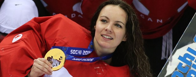 Gold-medal women's goalie signs with men's team. (Getty Images)