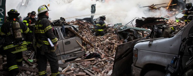 Crews battle a fire after an explosion at two New York City apartment buildings. (John Minchillo/AP)