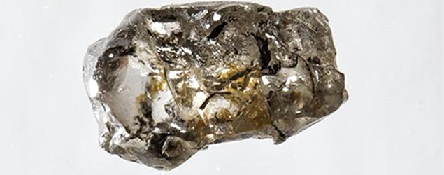 A diamond from Juína, Brazil, containing a water-rich inclusion of the olivine mineral ringwoodite. (via LiveScience.com)