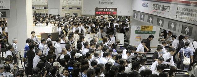 Stranded passengers rush to ticket gates after train service was resumed on the Keio Line at Shinjuku station in Tokyo on Wednesday Sept. 21, 2011 as powerful Typhoon Roke barreled across central Japan with heavy rains and sustained winds of up to 100 mph (162 kph). (AP Photo/Kyodo News)