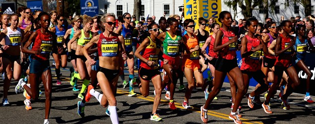 Runners take off from the Boston Marathon start line. (Getty Images)